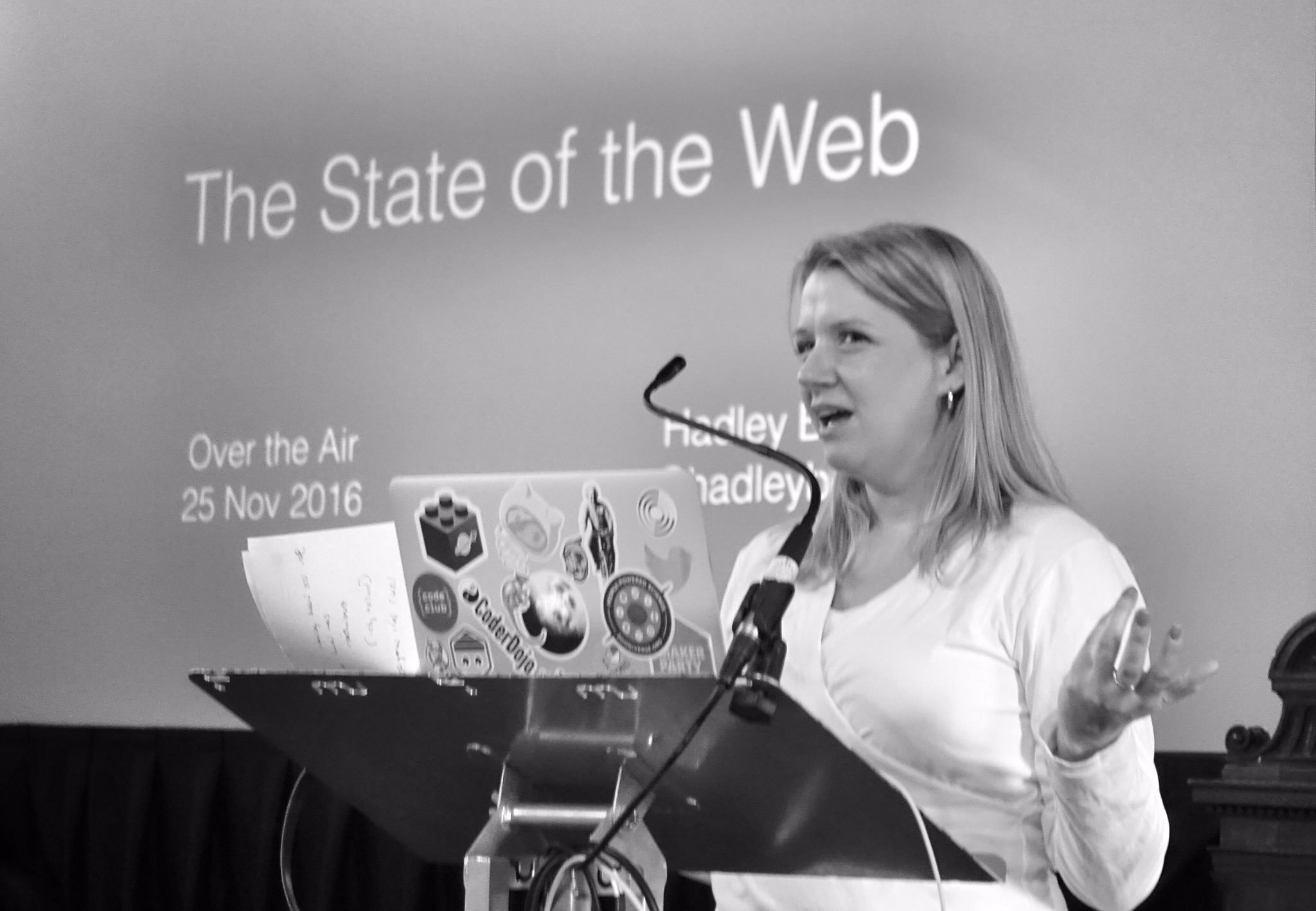 Photo of Hadley at a podium, in front of a slide that says State of the Web
